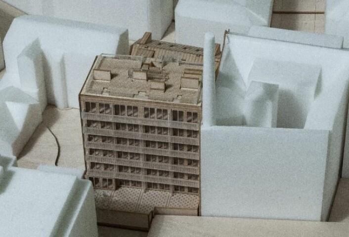 Modellen forestiller bygningen slik den ville sett ut dersom ikke kommunaldeprtementet hadde satt en endelig stopper. Illustrasjon: Grape arkitekter