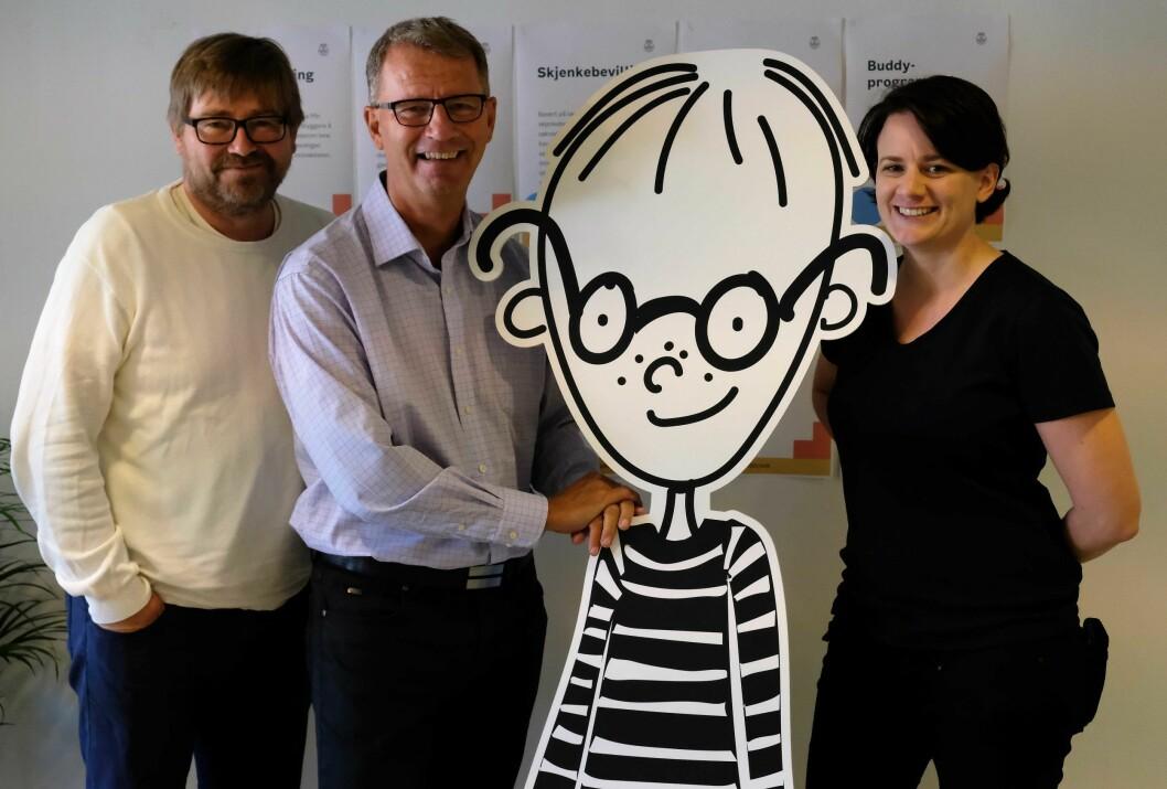 Sammen med den digitale maskotten Timm jobber Thorbjørn Moen, finansbyråd Robert Sten og Ingvild Sundby for å gjøre Oslo til den ledende digitale kommunen i landet. Foto: Christian Boger