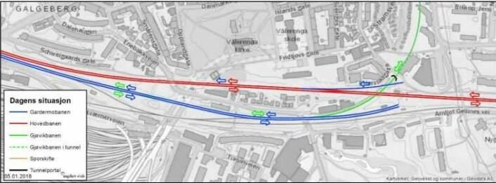 Husene i Enebakkveien, mellom det røde og blå sporet, skal vekk, ifølge Bane Nor. Illustrasjon: Bane Nor