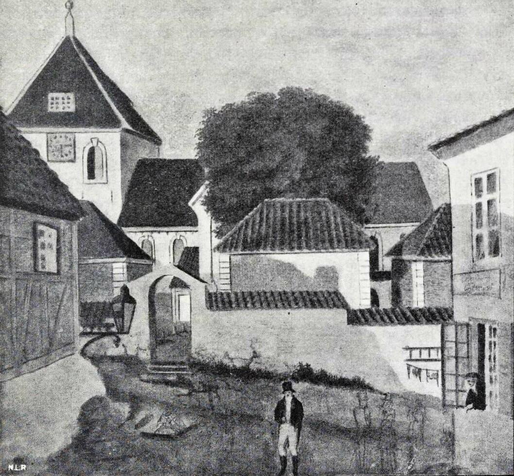 De gamle gravkapellene ved Vor frelsers kirke, dagens Oslo domkirke ved Stortorvet. Gouache av Jacob Munch fra circa 1820. Motivet er sett fra Lille Kirkebakke ut mot Kirkebakken - dagens Karl Johans gate. Tre av domkirkens fire gravkapeller som lå ut mot Kirkebakken er med, disse er fra venstre mot høyre; familien Colletts gravkapell, familien Vogts kapell og helt til høyre familien Leuchs kapell. Det fjerde kapellet - det Elieson-Ankerske - er ikke med på bildet.