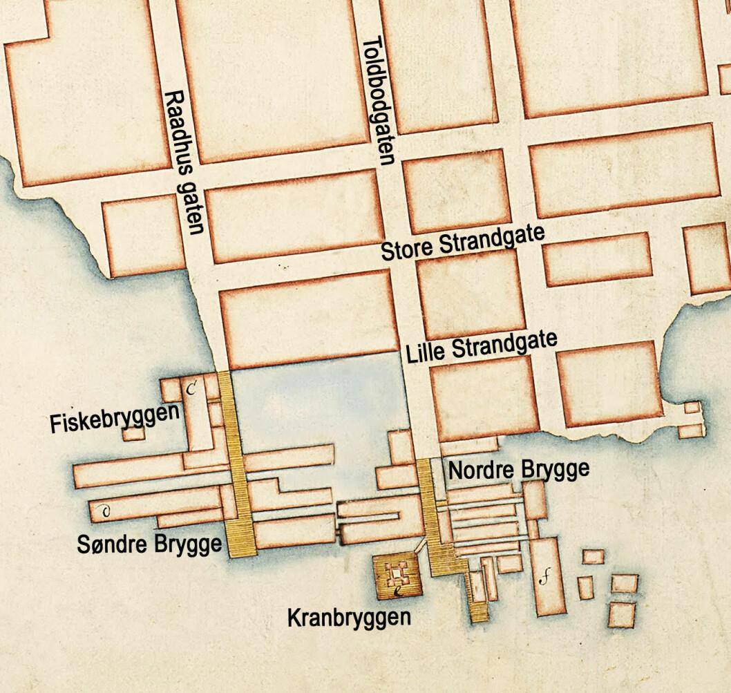 Slik ble havna i Christiania fremstilt i kart fra begynnelsen av 1700-tallet. Gate- og bryggenavn er satt inn av designeren. Bearbeidet utsnitt av kart: Amt 2 Kristiania 5-6 1704, Schøller/ Kartverket. Copyright: Lipsab 2019