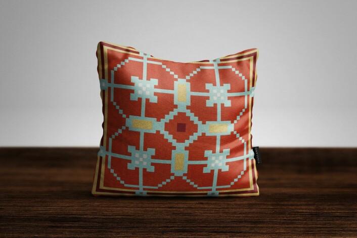 Puta Breime fra Kristiania Design, inspirert av Gustav Vigeland i hytterød med klassisk geometrisk mønster. Foto: Kristiania Design