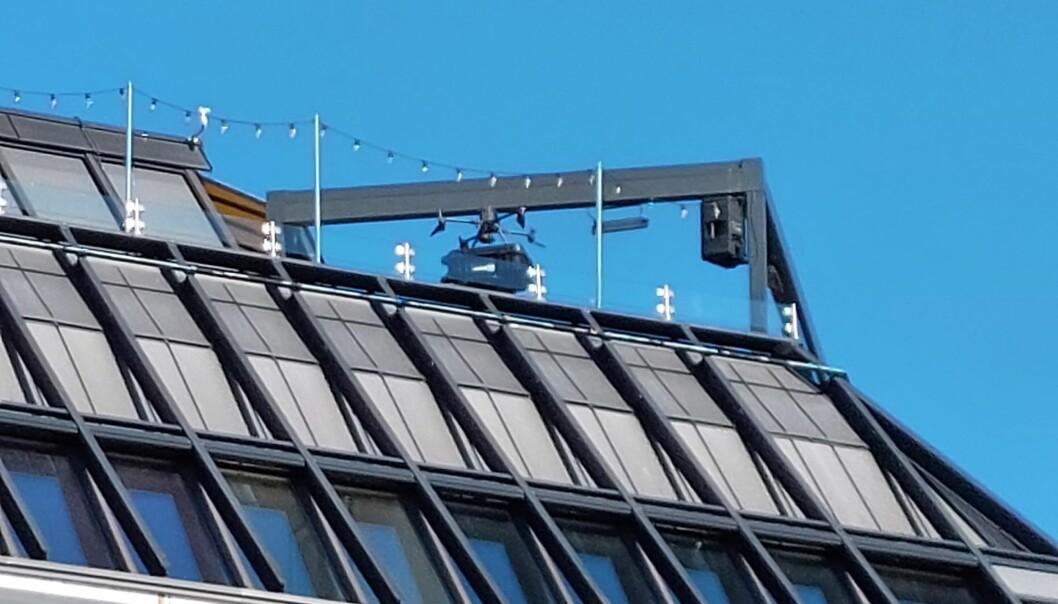 Politiet overvåkingsdrone brukte takterrassen på Grand hotell som landingsplass.